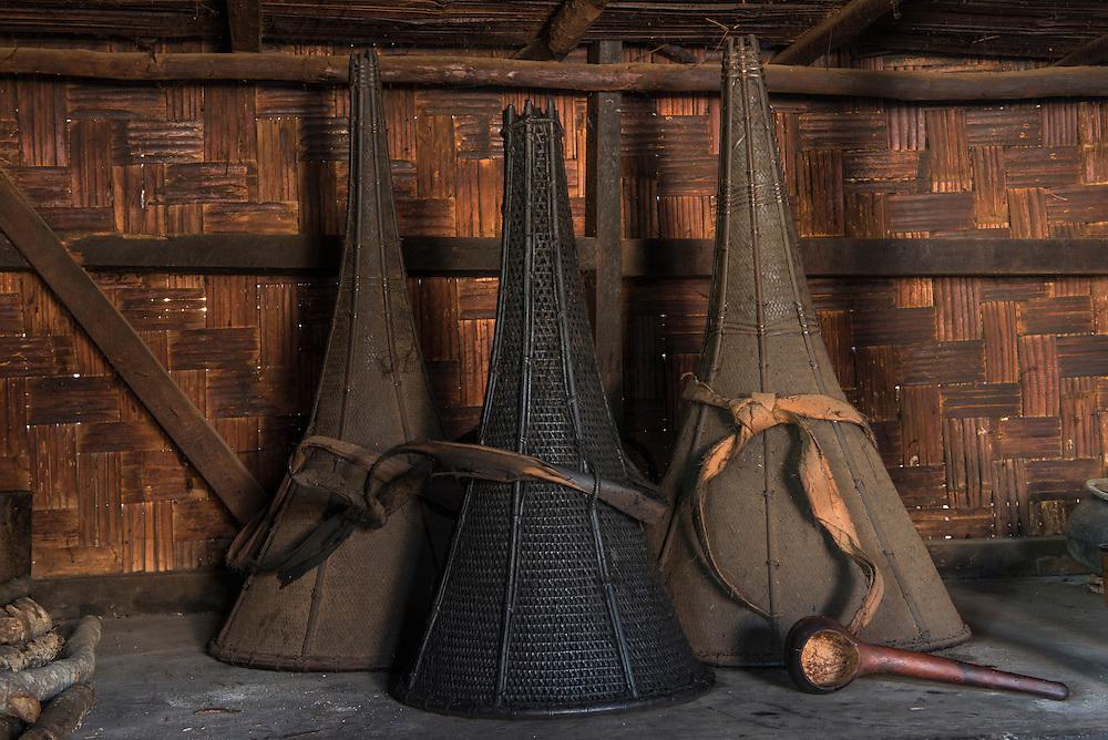 Ao Naga rice baskets in house<br /> Ao Naga headhuntingTribe<br /> Mokokchung district<br /> Nagaland,  ne India