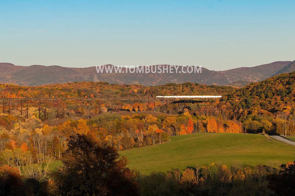 Cornwall, New York - A commuter train crosses the Moodna Viaduct on Oct.26, 2015. The mountains of the Hudson Highands on the east side of the Hudson River are in the background.