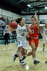 BLOOMINGTON, IL - December 15: Sydney Shanks and Alyssa Cruz during a college women's basketball game between the IWU Titans  and the Carroll Pioneers on December 15 2018 at Shirk Center in Bloomington, IL. (Photo by Alan Look)