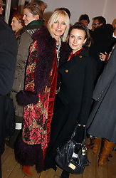 Left to right, VIRGINIA BATES and her daughter  DAISY BATES at a private view of artist Natasha Law's work entitled 'Hold' held at Eleven, 11 Eccleston Street, London SW1 on 12th January 2006.<br /><br />NON EXCLUSIVE - WORLD RIGHTS