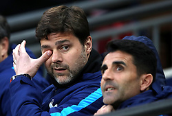 Tottenham Hotspur manager Mauricio Pochettino (left) during the Premier League match at Wembley Stadium. London.