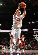 CHARLOTTESVILLE, VA- NOVEMBER 13: James Johnson #34 of the Virginia Cavaliers grabs a rebound during the game on November 13, 2011 at the John Paul Jones Arena in Charlottesville, Virginia. Virginia defeated South Carolina State 75-38. (Photo by Andrew Shurtleff/Getty Images) *** Local Caption *** James Johnson