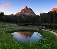 The Tre Cime di Lavaredo at sunset, from Lake Antorno
