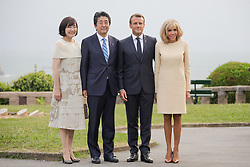 French President Emmanuel Macron and his wife Brigitte Macron welcome Japanese Prime Minister Shinzo Abe and his wife Akie Abe at the Biarritz lighthouse, southwestern France, ahead of a working dinner on August 24, 2019, on the first day of the annual G7 Summit. Photo by Thibaud Moritz/ABACAPRESS.COM