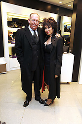 BRIAN CRAWFORD and CHERYL HOWARD at the MCM Christmas party held at their store at 5 Sloane Street, London on 26th November 2008.