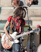 05 November 2012:  Aerosmith's Joe Perry performs during the bands free concert in Boston's Allston neighborhood in front of the apartment building, 1325 Commonwealth Ave, which was the band's home in the early 1970's.  Boston, MA. ***Editorial Use Only*****