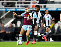 Football - 2021 / 2022  EFL Carabao Cup - Round Two - Newcastle United vs Burnley - St Jame's Park - Wednesday 25th August 2021<br /> <br /> Allan Saint-Maximin of Newcastle United vies with Josh Brownhill of Burnley<br /> <br /> Credit: COLORSPORT/Bruce White