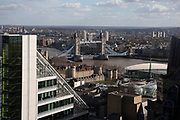 Views of the cityscape skyline looking towards Tower Bridge from The Garden at 120, the City of London's largest rooftop public space, located atop the newly opened Fen Court office building at 120 Fenchurch Street in London, United Kingdom. At 15-storeys up, the viewing platform offers exceptional 360-degree views of the City and greater London, and is free for members of the public to visit.