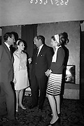 """11/10/1966<br /> 10/11/1966<br /> 11 October 1966<br /> Fashions, Blarney by Clodagh. Silverline Fashions of Nenagh (Co. Tipperary) launching its 1967 collection """"Blarney by Clodagh"""" at the Royal Hibernian Hotel, Dublin. Silverline Fashions Ltd. was a subsidiary company of Martin Mahoney and Co. Ltd. Cork. Picture shows (l-r): Mr M. Crauford Mahony, Sales Director Martin Mahoney and Bros Ltd.; Clodagh O'Kennedy (Phibbs),  """"Clodagh""""; Mr George Colley T.D. Minister for Industry and Commerce who penned the show and Suzanne McDougan modelling one of the garments from the collection."""