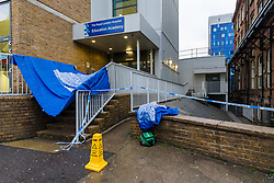 © Licensed to London News Pictures. 13/10/2019. London, UK. The police crime scene cordon in Turner Street at the back of the Royal London Hospital in Whitechapel, east London. Police were called at 2:05pm yesterday, 12th October to reports of men fighting in Turner Street and a man with multiple stab wounds was taken to hospital where his condition was described as critical. Two men were arrested at the scene by police on suspicion of attempted murder. Photo credit: Vickie Flores/LNP