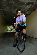 Cyclist contemplating on road bike in tunnel