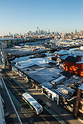 A view of Gowanus and downtown Brooklyn from the Smith-9th Street subway platform. The elevated subway track approaching the station can be seen in the upper left.