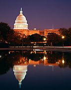 Light at dusk illuminating the United States Capitol Building with the Reflecting Pool in the foreground, Washington, District of Columbia.