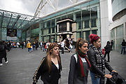 People out shopping in the public outdoor space at the Bullring in Birmingham, United Kingdom. The Bullring is a major commercial area of central Birmingham. It has been an important feature of Birmingham since the Middle Ages, when its market was first held. Two shopping centres have been built in the area in the 1960s, and then in 2003 the latter is styled as one word, Bullring.