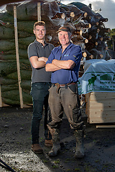director Euan Duff and his son Dougie Duff, of Dufftrees, out at the big xmas  trees, Christmas Tree Farm Wester Auchentroig Farm, Nr Buchlyvie. The tree farm is donating trees for the Highland villages who've had their free trees taken off them this year.