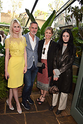 Left to right, Georgia Packham Anderson, Matthew Anderson, Jenny Packham and Isabella Packham Anderson at The Ivy Chelsea Garden Summer Party, Kings Road, London, England. 14 May 2018.