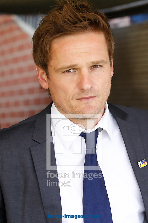 Picture by Andrew Tobin/Focus Images Ltd +44 7710 761829.27/04/2013. AFC Wimbledon manager Neal Ardley looks on during the npower League 2 match at the Cherry Red Records Stadium, Kingston.