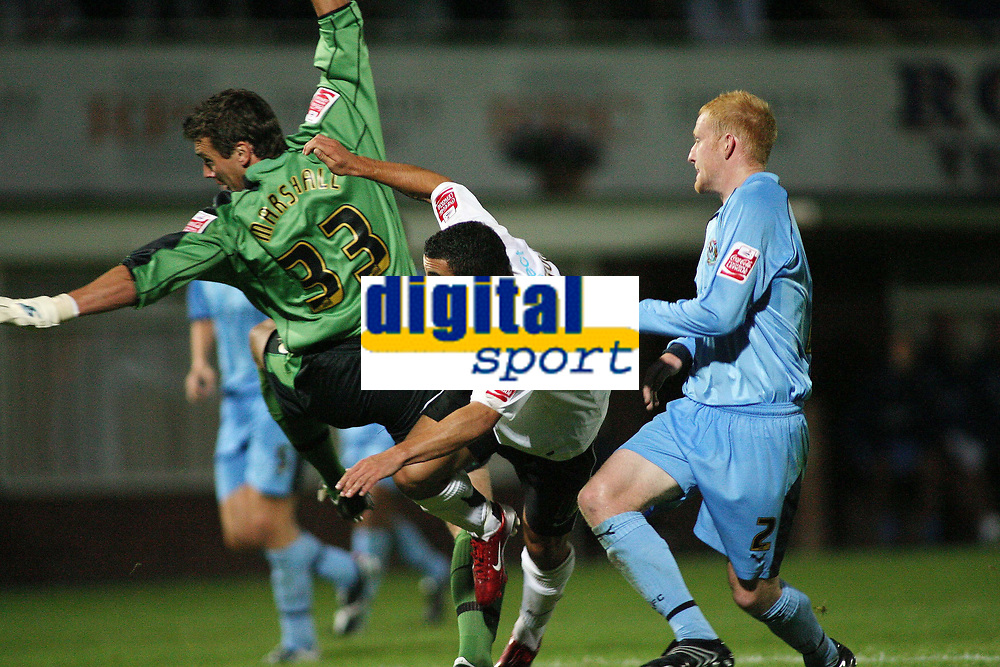 Photo: Rich Eaton.<br /> <br /> Hereford United v Coventry City. Carling Cup. 22/08/2006. Stuart Fleetwood of Hereford heads past goalkeeper Andy Marshall to give Hereford a 2 goal lead
