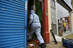 © Licensed to London News Pictures. 31/12/2018. West London, UK. Forensic officer enters the property of a mass arrest. A man in his 30s was left fighting for his life after being stabbed on Fulham Palace Road in an unprovoked attack in the early hours of New Years Eve. Police have arrested 39 individuals at a party at a near by address where the assailant ran to following the attack according to eye witnesses. Photo credit Guilhem Baker/LNP