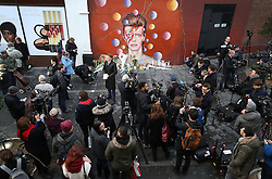© Licensed to London News Pictures. 11/01/2016. London, UK. Reporters gather round a mural of David Bowie in Brixton. The Death of David Bowie, who was born in Brixton, has been announced today.  Photo credit: Peter Macdiarmid/LNP
