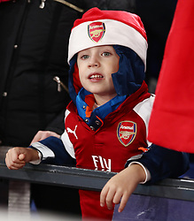 """A young Arsenal fan before the Premier League match at Selhurst Park, London. PRESS ASSOCIATION Photo. Picture date: Thursday December 28, 2017. See PA story SOCCER Palace. Photo credit should read: John Walton/PA Wire. RESTRICTIONS: EDITORIAL USE ONLY No use with unauthorised audio, video, data, fixture lists, club/league logos or """"live"""" services. Online in-match use limited to 75 images, no video emulation. No use in betting, games or single club/league/player publications."""
