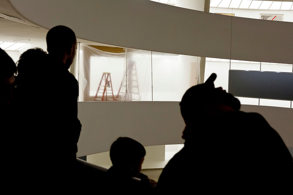 visitors of the Solomon R. Guggenheim Museum looking at the spiral ramp during installation of a new show