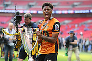 Chuba Akpom of Hull City lifts the Sky Bet Championship Playoff Trophy. Skybet football league Championship play off final match, Hull city v Sheffield Wednesday at Wembley Stadium in London on Saturday 28th May 2016.<br /> pic by John Patrick Fletcher, Andrew Orchard sports photography.
