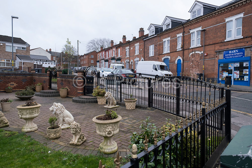 Lions and other ornaments outside a home in Balsall Heath on 18th January 2020 in Birmingham, United Kingdom. Ornamental lions are often associated with stately homes, but here are outside inner city terraced houses.