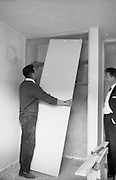 18/05/1966<br /> 05/18/1966<br /> 18 May 1966 <br /> I.C.I. House at Kilcroney, Co. Wicklow for F.M. Cunneen of Imperial Chemical Industries (Ireland) Ltd., South Frederick Street, Dublin. Workmen fit the Wardrobe doors.