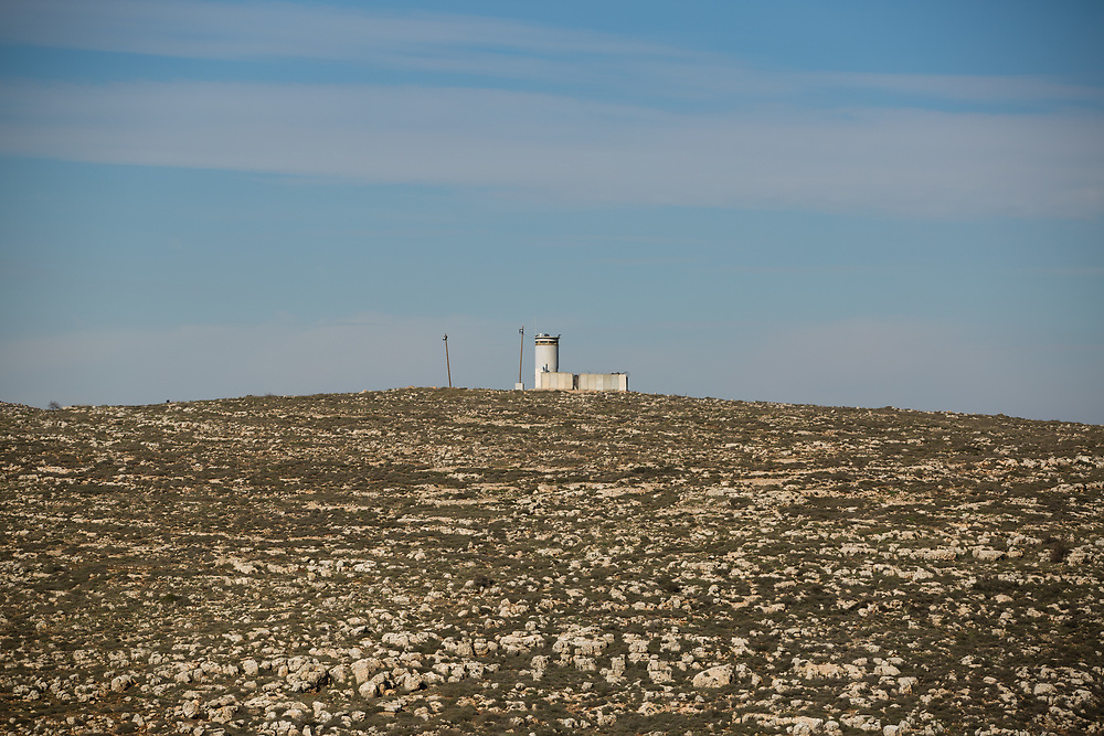 A fortified Israeli military security post is seen from 'Bikta Bakerem' bed and breakfast, which is advertised on Airbnb international home-sharing site and rental listings service, in the West Bank Jewish outpost of Esh Kodesh, on January 28, 2016.
