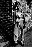 Youth slouching against brick wall Photo by Richard Saunders 1983