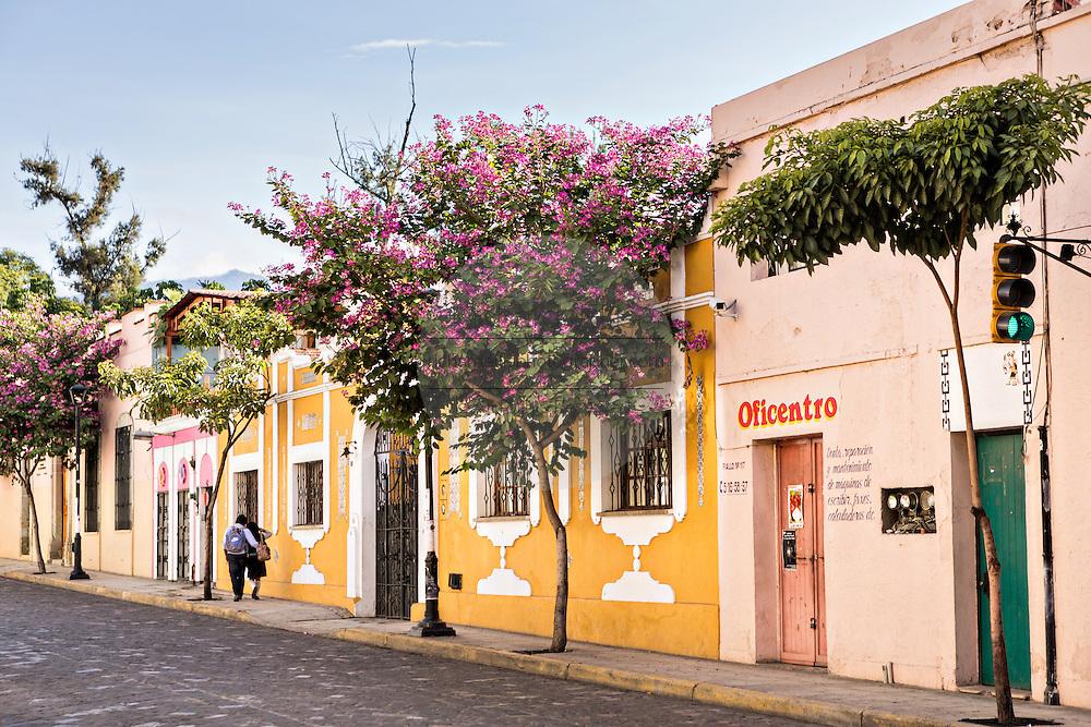 A young couple walks through the historic district Oaxaca, Mexico.