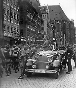 Adolf Hitler (1889-1945) Austrian-born German Chancellor, standing in a car taking the salute at a parade of SA troops, Nuremberg, 1935.   Nazi Fascist