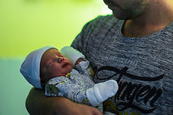 © Licensed to London News Pictures . 25/02/2021. Bolton , UK . Father CHRIS NORVALL (30) holds his one-day-old son RORY JOHN NORVALL . A look at maternity wards at the Royal Bolton Hospital during Coronavirus restrictions . Photo credit : Joel Goodman/LNP
