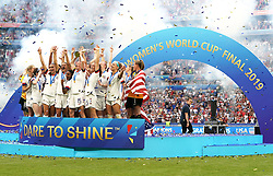USA's Megan Rapinoe (centre) and team-mates celebrate with the FIFA Women's World Cup Trophy after the final whistle