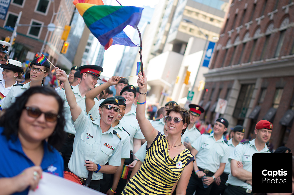 Members of the armed forces march with the pride parade. August 24, 2014.