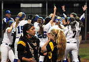 (Mara Lavitt — New Haven Register) <br /> June 14, 2014 West Haven<br /> CIAC Class LL softball championship between Southington and Amity. Southington won in the 15th inning with the only run of the game -- a home-run by Rachel Dube. Amity's catcher Janaya Young and pitcher Katie Koshes after their loss.<br /> mlavitt@newhavenregister.com
