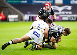 Olly Cracknell of Ospreys is tackled by Joe Taufete'e of Worcester Warriors<br /> <br /> Photographer Simon King/Replay Images<br /> <br /> European Rugby Challenge Cup Round 5 - Ospreys v Worcester Warriors - Saturday 12th January 2019 - Liberty Stadium - Swansea<br /> <br /> World Copyright © Replay Images . All rights reserved. info@replayimages.co.uk - http://replayimages.co.uk