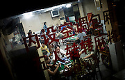 Chinese people play domino and typical Chinese chess called mahjong in a game room in Guilin, China, July 24, 2014.<br /> <br /> Food and games are a real pleasure for the life of Chinese community. <br /> At home, in the streets, at the park or in restaurants, the chance to find someone eating or playing is considerably high.<br /> <br /> © Giorgio Perottino