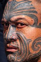 Maori man with ta moko (facial tatoo), Manurewa Sunday Market, Auckland, New Zealand