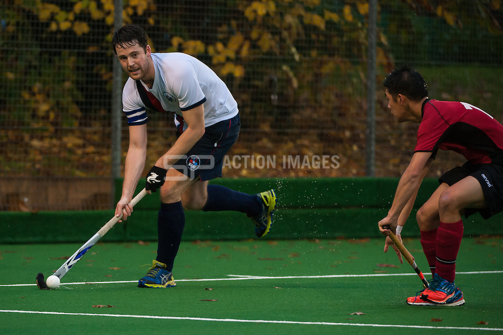 Brooklands Peter Flanagan dribbles the ball out of the circle. Southgate v Brooklands MU - Now: Pensions Men's Hockey League - Premier Division, Trent Park, London, UK on 23 November 2014. Photo: Simon Parker