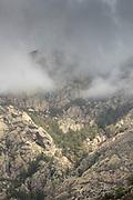 Mountains under cloudy sky, Col de Bavella, Corsica, France