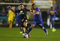 Kyle Lafferty of Nowrich City and James Wesolowski of Shrewsbury Town