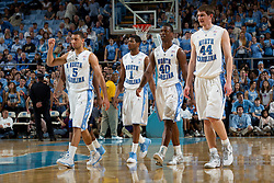 CHAPEL HILL, NC - FEBRUARY 15: Kendall Marshall #5, Dexter Strickland #1, Harrison Barnes #40 and Tyler Zeller #44 of the North Carolina Tar Heels walk back on the court after a timeout while playing against the Wake Forest Demon Deacons at the Dean E. Smith Center in Chapel Hill, North Carolina. North Carolina won 64-78. (Photo by Peyton Williams/UNC/Getty Images) *** Local Caption *** Kendall Marshall;Dexter Strickland;Harrison Barnes;Tyler Zeller