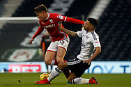 Ryan Fredericks of Fulham (R) tackles Marley Watkins of Barnsley (L). EFL Skybet championship match, Fulham v Barnsley at Craven Cottage in London on Saturday 23rd December 2017<br /> pic by Steffan Bowen, Andrew Orchard sports photography.