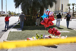 Oct 3, 2017 - Las Vegas, Nevada, U.S. - FBI sweep the area close to a makeshift memorial inside the perimeter of a police barricade on the Las Vegas Strip Tuesday. A mass shooting occurred late Sunday evening nearby at a music festival. (Credit Image: © Ronda Churchill via ZUMA Wire)