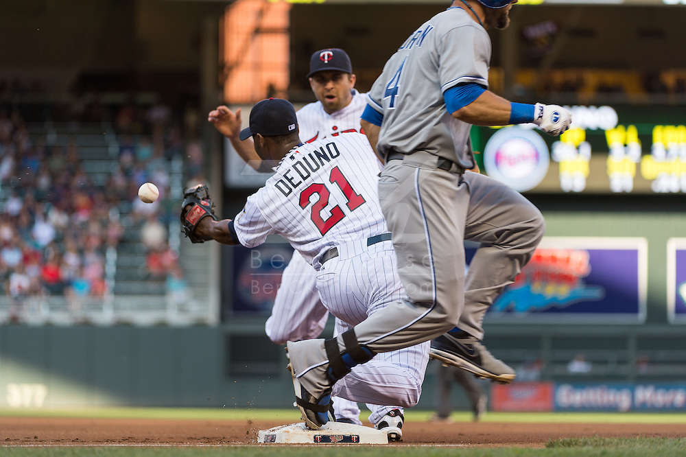 Brian Dozier #2 of the Minnesota Twins attempts to flip the ball to Samuel Deduno #21 unsuccessfully during a game against the Kansas City Royals on June 27, 2013 at Target Field in Minneapolis, Minnesota.  The Twins defeated the Royals 3 to 1.  Photo by Ben Krause