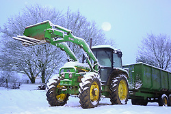 © Licensed to London News Pictures. 19/01/2019. Gillamoor, UK. A tractor covered in heavy Snowfall in the town go Gillamoor in North Yorkshire as temperatures across the UK drop. Photo credit: London News Pictures.