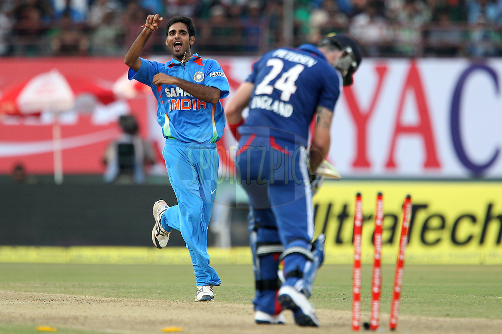Bhuvneshwar Kumar of India celebrates the wicket of Kevin Pietersen of England during the 2nd Airtel ODI Match between India and England held at the Jawaharlal Nehru International stadium, Kochi, India on the 15th January 2013..Photo by Ron Gaunt/BCCI/SPORTZPICS ..Use of this image is subject to the terms and conditions as outlined by the BCCI. These terms can be found by following this link:..http://www.sportzpics.co.za/image/I0000SoRagM2cIEc