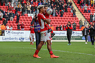 Charlton Athletic attacker Lyle Taylor (9) smiling and holding child with Taylor on his shirt during the EFL Sky Bet League 1 match between Charlton Athletic and Rochdale at The Valley, London, England on 4 May 2019.